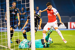 Oliver Giroiud #12 of Arsenal F.C. vs Eduardo Carvalho #24 of GNK Dinamo Zagreb during football match between GNK Dinamo Zagreb, CRO and Arsenal FC, ENG in Group F of Group Stage of UEFA Champions League 2015/16, on September 16, 2015 in Stadium Maksimir, Zagreb, Croatia. Photo by Ziga Zupan / Sportida