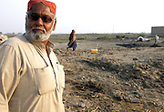Mushtaq, a village elder, pictured in front of the mud and debris-strewn plot of land where his house used to stand, a few miles outside the city of Jacobabad in Pakistan's Sindh Province. <br /> <br /> Like hundreds of thousands of others, his home was washed away when flood waters inundated the area following 10 year's worth of rain which fell in northern Pakistan in July and August 2010.<br /> <br /> Mushtaq's village is one of hundreds that are being helped to recover from the disaster by the NGO Mercy Corps, with the support of funding from the British government's Department for International Development.<br /> <br /> Mercy Corps have installed clean water pumps and basic sanitation in the village, to help meet people's basic needs as they return home after the flood waters subside. But for people like Mushtaq, clean water is just the first step on the road to recovery. Shelter remains a huge priority - many thousands of families will spend this winter living in tents.<br /> <br /> &quot;We are grateful for the clean water and the latrines, as people were getting sick before, but now they are not&quot;, says Mushtaq.<br /> <br /> &quot;But somehow we must rebuild our home. We lost almost everything in the floods. Life is very hard now, but we hope to get some seed so that we can grow rice and wheat again and support ourselves once more.&quot;<br /> <br /> Find out more about the UK government's response to the Pakistan floods at www.dfid.gov.uk/pakistan-floods-six-months ( http://www.dfid.gov.uk/pakistan-floods-six-months ) <br /> <br /> Image: DFID/Russell Watkins<br /> <br /> Terms of use<br /> <br /> This image is posted under a Creative Commons - Attribution Licence ( http://creativecommons.org/licenses/by/3.0/ ) , in accordance with the Open Government Licence ( http://www.nationalarchives.gov.uk/doc/open-government-licence/ ) . You are free to embed, download or otherwise re-use it, as long as you credit the source as 'Department for International Development'.