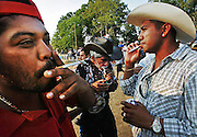 From left, Raul Guevarra Cheen, Francisco Sanchez and Miguel Gonzalez have a smoke as they wait the start of a race at Carriles Los Primos Torres race track in Saluda.
