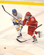 LSSU's Ben Power (left) tries to keep OSU Buckeye John Albert (right) from crossing into the Lakers zone during the third period of Friday nights game at Taffy Abel Arena in Sault Ste. Marie.