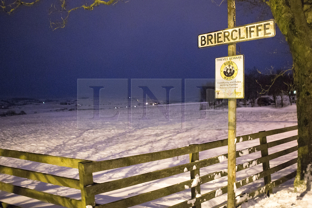 © Licensed to London News Pictures . 23/03/2013 . Burnley , UK . GV general view this evening (23rd March) of a street sign in Briercliffe , Burnley , Lancashire overlooking a valley as police announce the body of a 27 year old man has been recovered this afternoon (23rd March) in the snow nearby . Snowdrifts have made roads impassable . The man has been named locally as Gary Windle . Photo credit : Joel Goodman/LNP