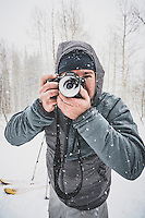 Photographer David Clifford field testing a snow lens cap, Marble on skis, Colorado.