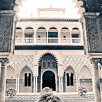 Original color Photograph has be desaturated and has a blue gold tint. 'Courtyard of the Maidens' or Patio de las Doncellas in the Royal Alc·zar (Palace) of Seville - 'Real Alc·zar de Sevilla'