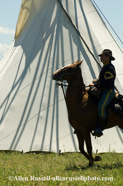 Custer's Last Stand Reenactment, Battle of the Little Bighorn, Crow Indian Reservation, Montana, 7th Cavalry soldier rides past tipi, <br /> MODEL RELEASED