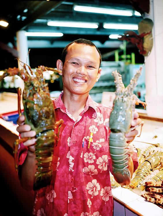 Waiter holding 2 large Phuket Lobsters