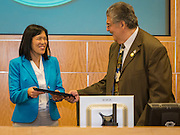 Anne Sung is welcomed to the Board by President Manuel Rodriguez after taking the oath of office to become Houston ISD Trustee for District VII, January 12, 2017.
