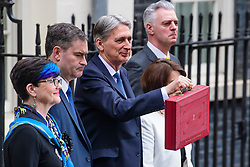 © Licensed to London News Pictures. 08/03/2017. London, UK. Baroness Neville-Rolfe, David Gauke MP, Chancellor of the Exchequer Philip Hammond MP, Jane Ellison MP and Simon Kirby MP leave 11 Downing Street in London before British Chancellor PHILIP HAMMOND delivers his 2017 Budget to Parliament. Photo credit: Ben Cawthra/LNP