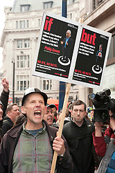 © under license to London News Pictures.  26/03/2011. Protest against tax avoidance by UK Uncut in Oxford Street, London, . Photo credit should read Tony Nandi/London News Pictures