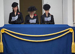 © Licensed to London News Pictures. 09/11/2014.  London.   From left to right - Princess of Cambridge Kate Middleton, Camilla Duchess of Cornwall and Sophie the Countess of Wessex stand on a balcony and watch the annual Remembrance parade at the Cenotaph this morning .  This year marks the 100th anniversary of the start of World War One, 70 years since the D-Day landings and the end of Britain's conflict in Afghanistan.    Photo credit : Alison Baskerville/LNP