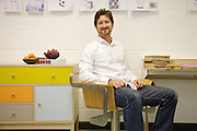 Leonhard Pfeifer, furniture designer, in his Hackney studio, London with the Abbeywood sideboard (left) manufactured in Estonia by Woodman and the Slope desk (right, it was awarded Design Guild Mark 2014) manufactured in Germany by Müller Möbelwerkstätten. He sits on the Apfuzi pedestal chair, manufactured in the UK.<br /> CREDIT: Vanessa Berberian for The Wall Street Journal<br /> GURU-Pfeifer