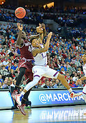 March 20, 2015: New Mexico State Aggies forward Pascal Siakam (43) and Kansas Jayhawks guard Kelly Oubre Jr. (12) battle for a pass during a second round game between No. 2 seed Kansas and No. 15 seed New Mexico State in the 2015 NCAA Men's Basketball Championship Tournament at CenturyLink Center in Omaha, Neb. Kansas defeated New Mexico State 76-57. Kansas defeated New Mexico State 76-57. Kansas defeated New Mexico State 76-57.
