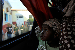 Migrants are taken to a coach to be transferred from Algiers to Tamanrasset, 2,000 km south of Algiers, Algeria on June 288, 2018. Nigerian illegal migrants (majority of women and children) who lived in Algeria by begging, according to the Algerian authorities, will be returned to their country once the administrative arrangements are completed. Photo by Louiza Ammi/ABACAPRESS.COM