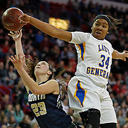 Appleton North's Paige Schabo is fouled while shooting by Milwaukee King's Jada Patterson during the first half of the Division 1 semifinals of the WIAA girls' state basketball championships Friday, March 10, 2017 in Green Bay, Wis.   (AP Photo/Matt Ludtke)