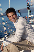 Man Sitting on Sailboat Deck