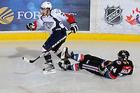 KELOWNA, CANADA, OCTOBER 5: Lukas Walter #20 of the Tri City Americans skates away after checking Tyson Baillie #24 of the Kelowna Rockets on October 5, 2011 at Prospera Place in Kelowna, British Columbia, Canada (Photo by Marissa Baecker/shootthebreeze.ca) *** Local Caption ***Lukas Walter;Tyson Baillie;