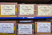 Shelves of Food Bank boxes waiting for distribution at Wadebridge foodbank, North Cornwall, England, United Kingdom. Single person and family boxes have been prepared by volunteers for people who are living in poverty and unable to buy food.