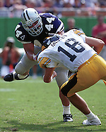 Kansas State defensive end Monty Beisel (44) sacks Iowa quarterback Mullen during game action at Arrowhead Stadium in Kansas City, Missouri in 2000.