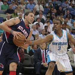 05 November 2008:  New Orleans Hornets guard Chris Paul (3) reaches in for the ball against Atlanta Hawks guard Mike Bibby (10) during the first half of a NBA game between the New Orleans Hornets and the Atlanta Hawks at the New Orleans Arena in New Orleans, LA..