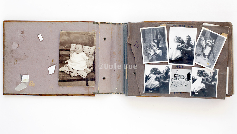 old falling apart photo album with vintage happy family moments images England