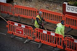 UK ENGLAND LONDON 15MAY12 - Contractors dig up Shirland Road in Maida Vale, west London......The trench that the crew hacked into the asphalt was filled the same day, apparently without either adding or removing any cables or pipework in the ground. In the face of public spending cuts and a drive to save taxpayers' money, this activity appears highly wasteful and unnecessary in times of recession.....jre/Photo by Jiri Rezac....© Jiri Rezac 2012