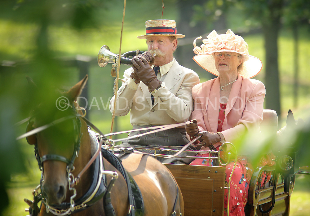 Driver Raymond Tuckwiller, riding with his wife Lynn, blows on a French post horn during the Carriage Association of America's Carriage Classic pleasure-driving show at the Kentucky Horse Park in Lexington, Ky., on Sunday, July 3, 2011. The horn was used to signal different intentions of the driver. The Tuckwillers are from Lewisburg, West Virginia. The carriage ride through the park was a culmination of the weekend's competition held by the CAA which included 2 days of ring competition and more than 60 competitors. Photo by David Stephenson