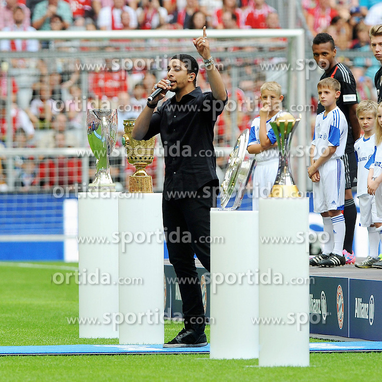 "09.08.2014, Allianz Arena, Muenchen, GER, 1. FBL, FC Bayern Muenchen, Saisoneröffung, im Bild Saenger Andreas Bourani singt seinen WM-Song ""Auf Uns"" // during the saison opening of German 1st Bundesliga Club FC Bayern Munich at the Allianz Arena in Muenchen, Germany on 2014/08/09. EXPA Pictures © 2014, PhotoCredit: EXPA/ Eibner-Pressefoto/ Stuetzle<br /> <br /> *****ATTENTION - OUT of GER*****"