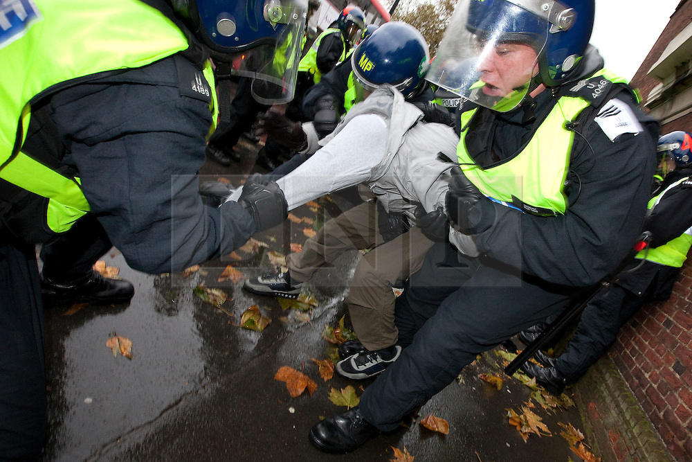 © under license to London News Pictures. 11/11/2010. A Muslims Against Crusaders protester is arrested following a confrontation with police during an MAC protest in Kensington, London on Armistice Day.