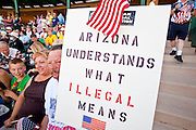 "May 29 - TEMPE, AZ: Opponents of illegal immigration at a rally organized by the Tea Party in Tempe, AZ, Saturday. About 3,000 people attended a ""Buy Cott Arizona"" rally at Tempe Diablo Stadium in Tempe, AZ Saturday night. The rally was organized by members of the Arizona Tea Party movement to show support for Arizona law SB1070. The ""Buy Cott"" is a reaction to the economic boycott planned by opponents of SB1070. SB1070 makes it an Arizona state crime to be in the US illegally and requires that immigrants carry papers with them at all times and present to law enforcement when asked to. Critics of the law say it will lead to racial profiling, harassment of Hispanics and usurps the federal role in immigration enforcement. Supporters of the law say it merely brings Arizona law into line with existing federal laws. Photo by Jack Kurtz"