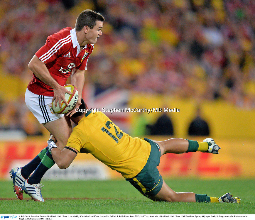 6 July 2013; Jonathan Sexton, British & Irish Lions, is tackled by Christian Lealiifano, Australia. British & Irish Lions Tour 2013, 3rd Test, Australia v British & Irish Lions. ANZ Stadium, Sydney Olympic Park, Sydney, Australia. Picture credit: Stephen McCarthy / SPORTSFILE