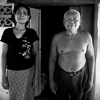 "SIEM REAP, FEBRUARY-28 : a Pol Pot survivor and mnetal patient ( R) poses with his wife in his house nearby Siem Reap..The country's entire infrastructure, including the health system, was destroyed during the Khmer Rouge reign and years of civil war. Only in recent years , several non governmental organizations have helped provide mental health services and training in the country in collaboration with local healers..Mental health service is relatively new to Cambodia, but much needed. Before the Pol Pot regime Cambodia only had one mental hospital for the whole population which was destroyed during the years of horror..Modest by western standards, the first mental health clinic for all of Cambodia was set up in Siem Reap by a team from Harvard University in 1994. .This is because many refugees settled down in and around Siem Reap. 102 doctors and counsellers were trained by the Harvard specialists in the late nineties as more than 80 percent of the population was traumatized by the Pol Pot years, and even more during their years in the refugee camps. Studies have shown that most  Cambodians showed PTSD ( Posttraumatic Stress Disorder) symptoms similiar to the Jewish survivors of concentration camps. . .As for the future, Cambodians are sceptical if there'd be a fair trial for the people . It'd be very difficult to bring patients to the capital Phnom Penh to witness . Due to Cambodias underdevelopped infrastructure, many Cambodians are even not aware of the trial preparations. There's no money and also many people do not want to be reminded. says a counselor in Siem Reap:""  it only would open old wounds. People rather suffer in silence"".."