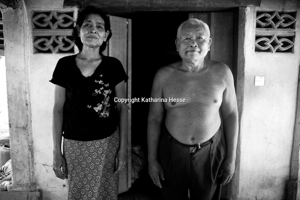 """SIEM REAP, FEBRUARY-28 : a Pol Pot survivor and mnetal patient ( R) poses with his wife in his house nearby Siem Reap..The country's entire infrastructure, including the health system, was destroyed during the Khmer Rouge reign and years of civil war. Only in recent years , several non governmental organizations have helped provide mental health services and training in the country in collaboration with local healers..Mental health service is relatively new to Cambodia, but much needed. Before the Pol Pot regime Cambodia only had one mental hospital for the whole population which was destroyed during the years of horror..Modest by western standards, the first mental health clinic for all of Cambodia was set up in Siem Reap by a team from Harvard University in 1994. .This is because many refugees settled down in and around Siem Reap. 102 doctors and counsellers were trained by the Harvard specialists in the late nineties as more than 80 percent of the population was traumatized by the Pol Pot years, and even more during their years in the refugee camps. Studies have shown that most  Cambodians showed PTSD ( Posttraumatic Stress Disorder) symptoms similiar to the Jewish survivors of concentration camps. . .As for the future, Cambodians are sceptical if there'd be a fair trial for the people . It'd be very difficult to bring patients to the capital Phnom Penh to witness . Due to Cambodias underdevelopped infrastructure, many Cambodians are even not aware of the trial preparations. There's no money and also many people do not want to be reminded. says a counselor in Siem Reap:""""  it only would open old wounds. People rather suffer in silence"""".."""