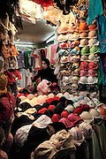 Woman in an underwear (bra) shop in Aleppo, Syria
