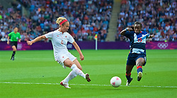 COVENTRY, ENGLAND - Friday, August 3, 2012: Canada's's Carmelina Moscato (L) and Great Britain's Eniola Aluko during the Women's Football Quarter-Final match between Great Britain and Canada, on Day 7 of the London 2012 Olympic Games at the Rioch Arena. Canada won 2-0. (Photo by David Rawcliffe/Propaganda)