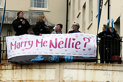 © Licensed to London News Pictures. 06/04/2014. Brighton, UK.  Lucy arranged for a big banner to be placed on the balcony of the Queens Hotel in Brighton to surprise Nellie with the Marriage Proposal while running the marathon . A marriage proposal took place during the Brighton Marathon today 6th April. Lucy Beasley proposed to Chantelle Dunstan who was running the marathon for Guidedogs.org. Photo credit : Hugo Michiels/LNP