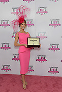 Krista Rosenberg, of Boca Raton, FL, smiles after wining the Longines Kentucky Oaks Day Fashion Contest, Friday, May 5, 2017, in Louisville, KY. Longines, the Swiss watch manufacturer known for its luxury timepieces, is the Official Watch and Timekeeper of the 143rd annual Kentucky Derby. (Photo by Diane Bondareff/AP Images for Longines)