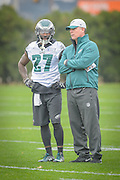 Philadelphia Eagles' former offensive coordinator, Pat Shurmur talks to safety Malcom Jenkins during Shurmur's first practice as interim head coach after the firing of Chip Kelly on Wednesday 30 December 2015 at the Nova Care Center in Philadelphia, Pa. . Photograph  by Jim Graham