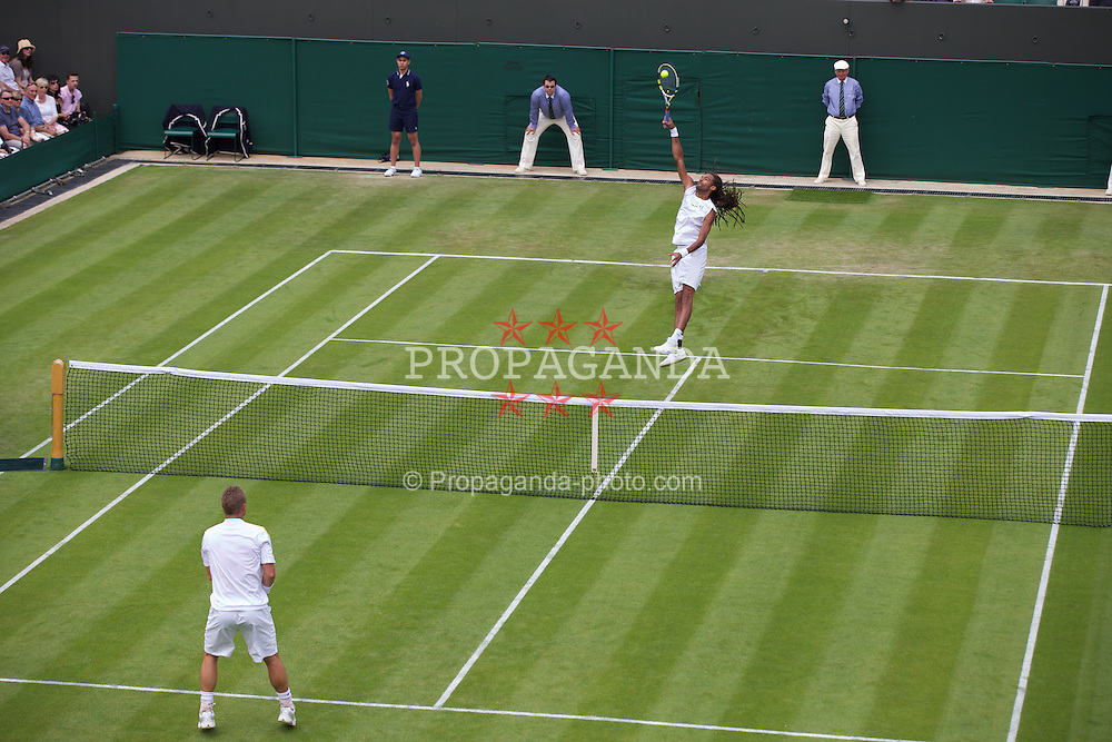 LONDON, ENGLAND - Wednesday, June 26, 2013: Dustin Brown (GER) during the Gentlemen's Singles 2nd Round match on day three of the Wimbledon Lawn Tennis Championships at the All England Lawn Tennis and Croquet Club. (Pic by David Rawcliffe/Propaganda)