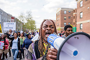 """Baltimore, Maryland - April 21, 2015: Lee Patterson, 60, from Baltimore chants """"Tell the truth & stop the lie. Freddie Gray didn't have to die,"""" while marching with several hundred protesters down N. Mount Street in West baltimore during a vigil-turned-protest march for the death of Freddie Gray. Gray was injured while detained by police, and died from his injuries Sunday. His spinal cord was 80% severed.<br /> <br /> CREDIT: Matt Roth for The New York Times<br /> Assignment ID: 30173645A"""