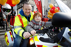No fee for Repro: 02/01/2013 .Pictured at the launch of Blood Bike East is comedian and motorcycle enthusiast, PJ Gallagher with Thomas Fegan (8) from Kiliney. Blood Bike East is a charitable organisation that delivers blood & medical products by motorbike between hospitals in Leinster free of charge. It is an entirely volunteer run organisation and Blood Bike East riders are highly trained and can safely negotiate traffic where large vehicles would be unable to do so, unless an emergency blue light vehicle is taken off an already overstretched service. DoneDeal's recent donation of ?32,309 facilitated the purchase of additional motorcycles and their maintenance which was key to today's launch that sees the service roll out across all of Leinster. Pic Andres Poveda