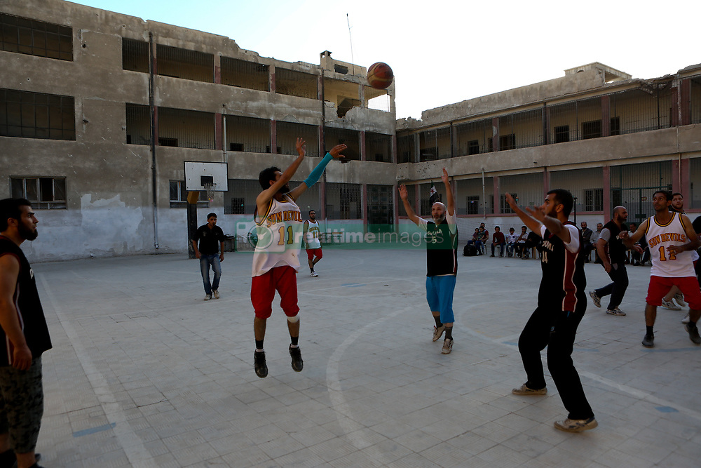 October 13, 2017 - Damascus, Syria - Friendly basketball match between Douma team and Erbeen team in Douma, Syria, 13 October 2017. Douma and Erbeenare are two cities besieged inside Eastern al-Ghouta. Eastern al-Ghouta, controlled by opposition forces, has been under siege by Assad forces for the last five years. (Credit Image: © Samer Bouidani/NurPhoto via ZUMA Press)