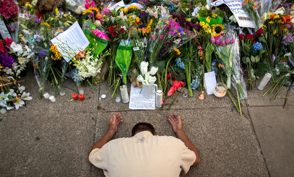 Raymond Smith of Charleston kneels in prayer the front of the Emanuel AME Church before a worship service, Sunday, June 21, 2015, in Charleston, S.C. (AP Photo/Stephen B. Morton)
