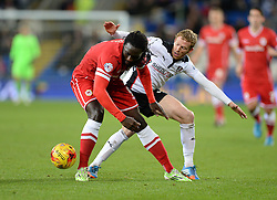 Cardiff City's Kenwyne Jones battles for the ball with Rotherham's Paul Green - Photo mandatory by-line: Alex James/JMP - Mobile: 07966 386802 - 06/12/2014 - SPORT - Football - Cardiff - Cardiff City Stadium  - Cardiff City v Rotherham United  - Football