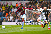Jonathan Kodjia of Aston Villa (26) and Adam Forshaw of Leeds United (4) in action during the EFL Sky Bet Championship match between Leeds United and Aston Villa at Elland Road, Leeds, England on 28 April 2019.