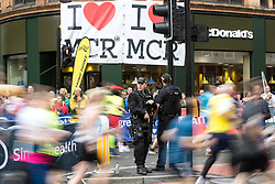 © Licensed to London News Pictures . 28/05/2017 . Manchester , UK . Armed police guard the starting stage of the run at the junction of Portland Street and Oxford Street in Manchester City Centre . The Great Manchester Run 2017 . Security is still heightened in Manchester following a murderous bomb attack at an Ariana Grande gig at Manchester Arena on Monday 22nd May . Photo credit : Joel Goodman/LNP