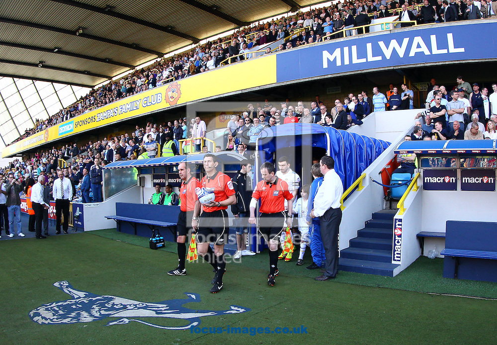 Picture by John Rainford/Focus Images Ltd. 07506 538356.24/03/12.Referee Lee Probert leads out Millwall and Leeds United before the Npower Championship match at The Den stadium, London.