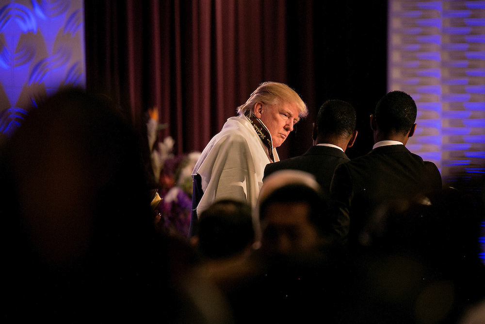 DETROIT, MI - SEPTEMBER 3, 2016: Republican presidential nominee Donald J. Trump dons a prayer shawl given to him by Bishop Wayne T. Jackson at a service at the Great Faith Ministries International church in Detroit, Michigan. CREDIT: Sam Hodgson for The New York Times.