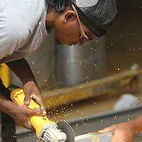 Webster Collins, a worker with Southland Construction, fabricates a bracket to help hold a metal wall panel that will go inside one of the kennel areas of the new Tupelo-Lee Humane Society building on Thursday morning. Officials say staff will start moving in July 1, but the organization still needs a final $200,000 to retire its debt from the building. The Tupelo-Lee Humane Society will be hosting a variety of fundraising activities this wummer to work on the debt.