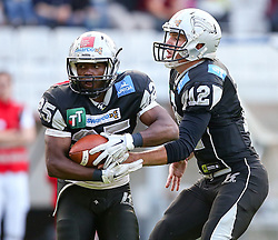 16.05.2015, Tivoli Stadion, Innsbruck, AUT, BATTLE4TIROL, Swarco Raiders Tirol vs Basel Gladiators, im Bild David Oku (Swarco Raiders Tirol, RB, #25) und Sean Shelton, (Swarco Raiders Tirol, QB, #12) // during the BATTLE4TYROL game between Swarco Raiders Tirol and Basel Gladiators at the Tivoli Stadion, Innsbruck, Austria on 2015/05/16. EXPA Pictures © 2015, PhotoCredit: EXPA/ Thomas Haumer