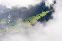 IFTE-NB-007652; Niall Benvie; View into the valley around Fliess from Kaunergrat visitor's centre; Austria; Europe; Tirol; horizontal; green; meadow forest woodland; 2008; July; summer; fog mist rain cloud; Wild Wonders of Europe Naturpark Kaunergrat