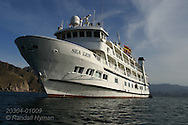Lindblad cruise ship Sea Lion moors in cove at Isla Danzante, Sea of Cortez, Baja, Mexico.